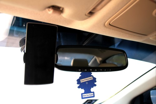 Phone Mount set up next to the rear view mirror.